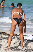 Nicole Murphy making something in the sand