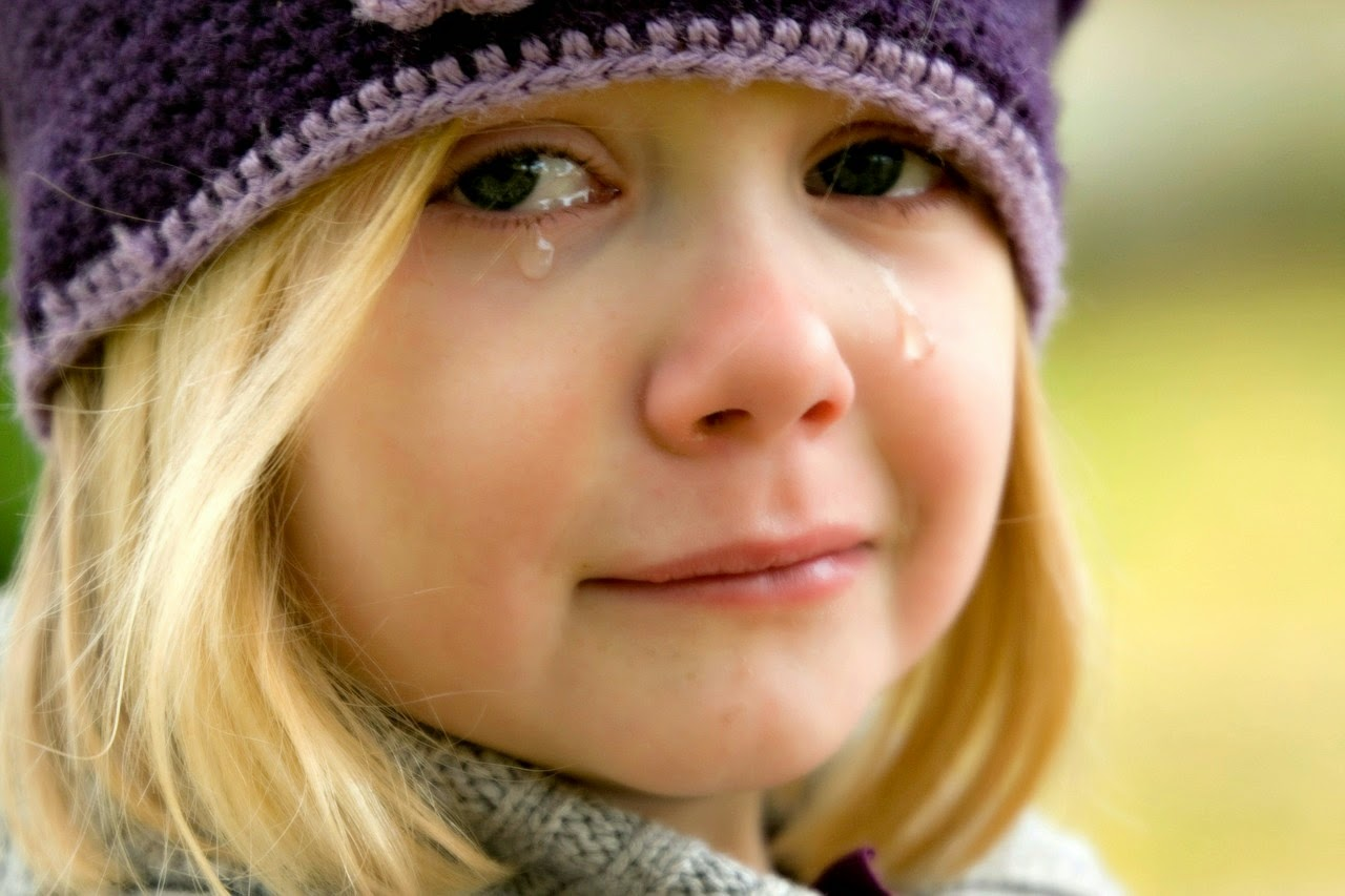 Girl crying experiencing grief