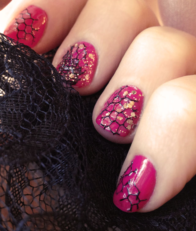 pink nails with fishnet and gold glitter