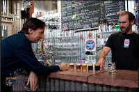 Oskar Blues Head Brewer Dave Chichura & Old Chicago's Mark Newman Converse Over Beer Samples.