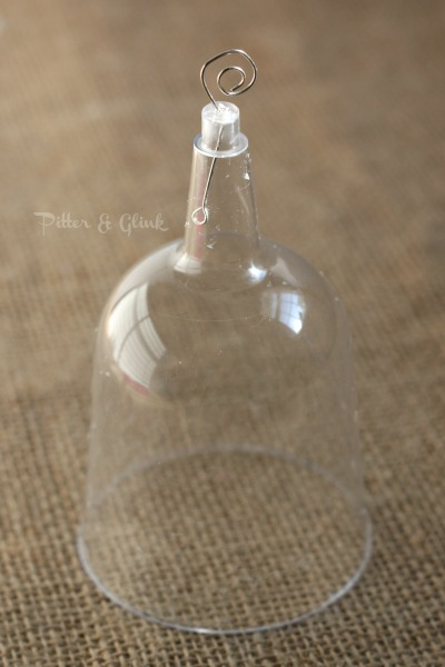 Create a beautiful snow globe ornament from a dollar store plastic wine glass! pitterandglink.com