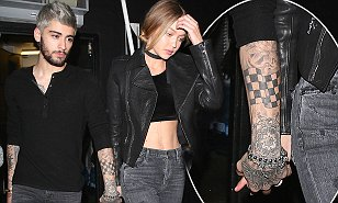 No hiding it now! Gigi Hadid holds hands with Zayn Malik as pair step out in matching looks after yet another date night