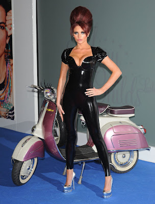 Amy Childs Posing in Black Latex Catsuit at Launch
