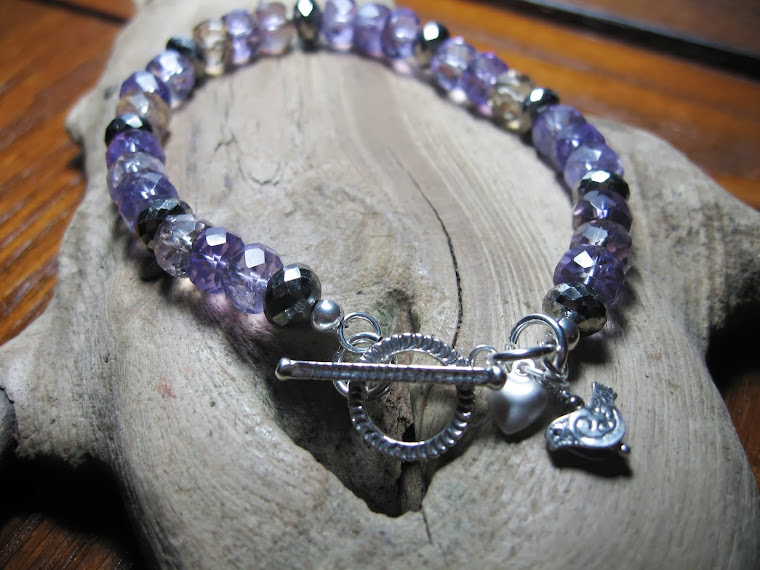 Ametrine and Rare white pyrite braclet with ornate Bird charm.