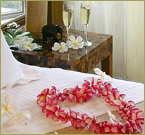 Flowers on the bed at Holualoa Inn