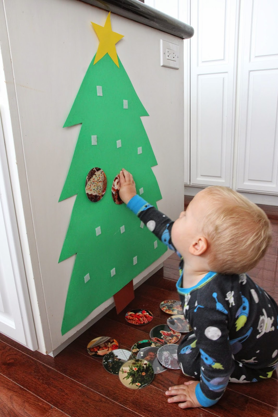 once the kids were done hanging all of the photo ornaments then they would pull them down again and put them back up in different places