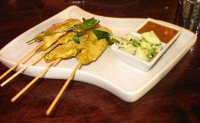 Chicken satay with cucumber and satay sauce