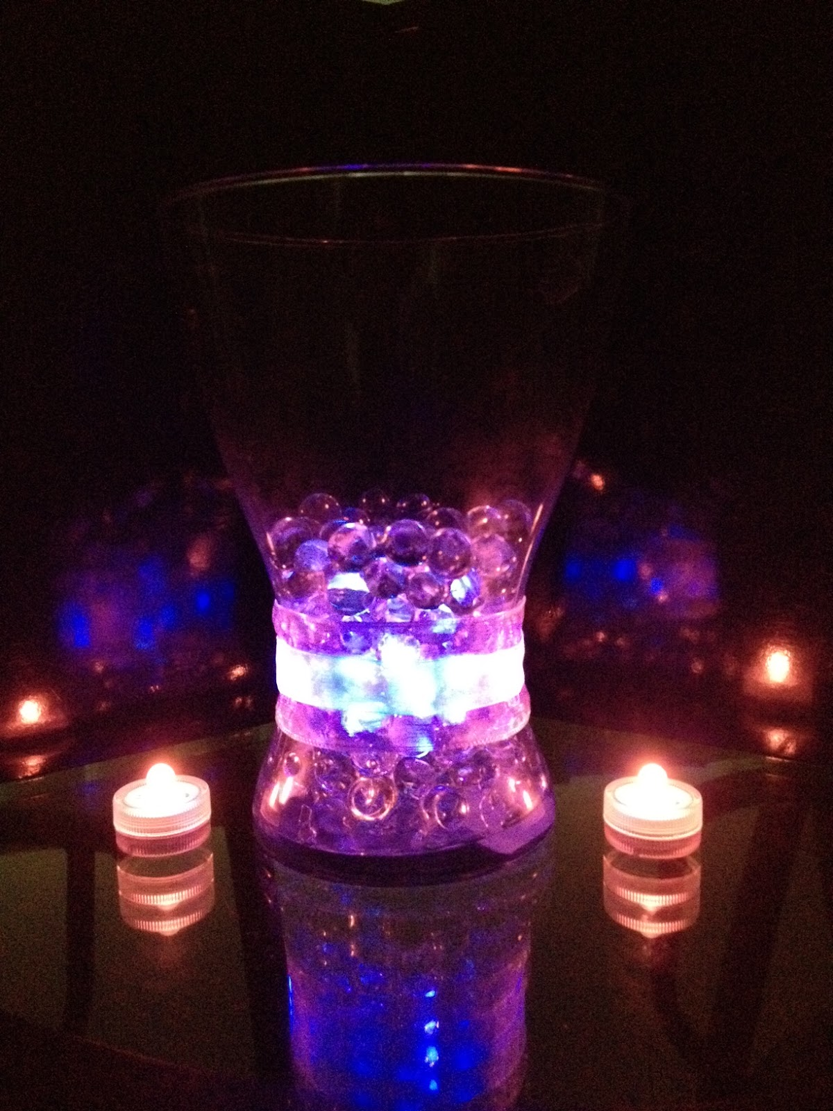 Wedding Centerpieces With Submersible Lights : Purple and pink submersible lights, water pearls, ribbons, and an Ikea ...