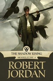 Cover of The Shadow Rising, featuring a young, dark-haired white man with a spear over his shoulder walking away from a mist-shrouded tree.