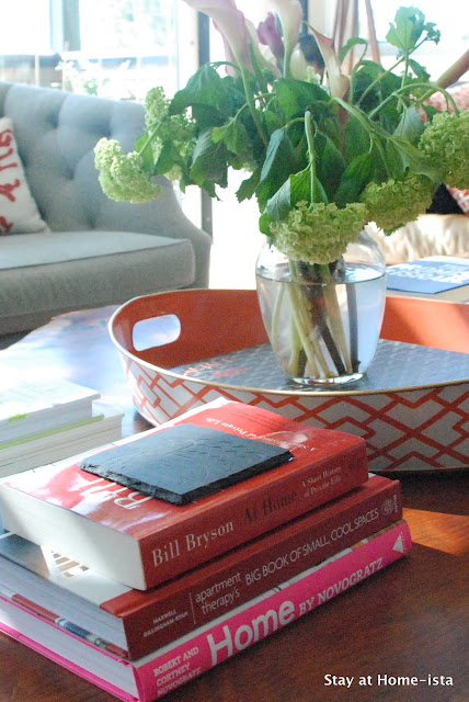 styling a coffee table with stacks of books- adds interest and color