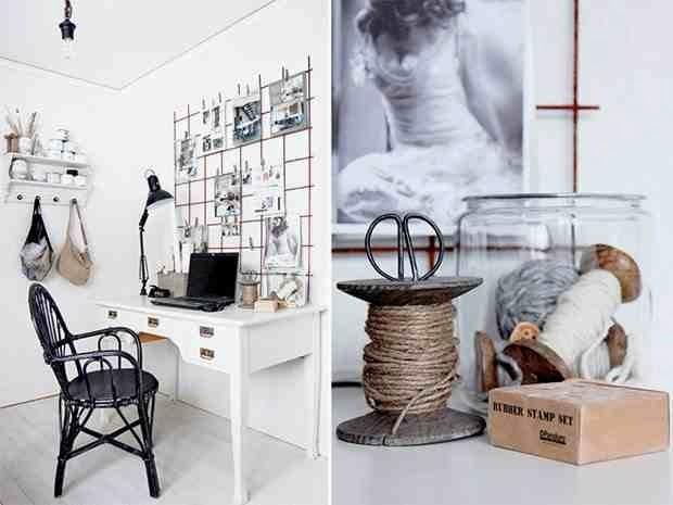 Dodatki z recyklingu, żarówka na czarnym kablu, czarne krzesło przy białym biurku