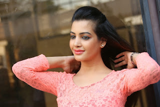 Diksha Panth in Beautiful Orange Top and White Trousers Spicy Pics