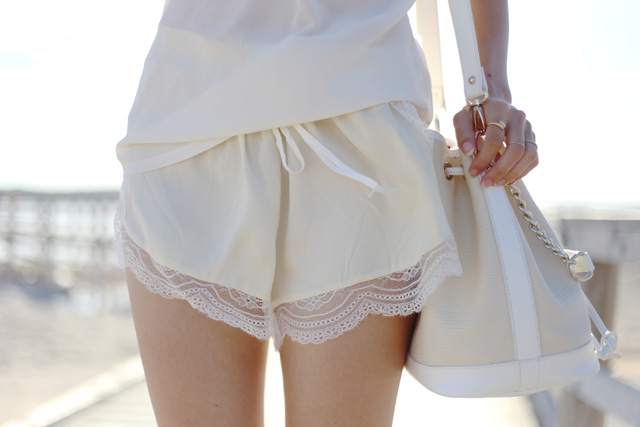 Lover The Label silk lace trim shorts in ivory & Niclaire leather bucket bag.