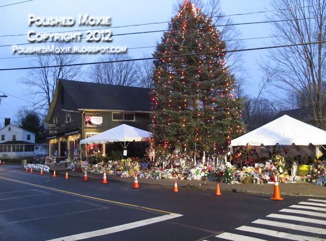 Image of Sandy Hook memorials spreading along road.