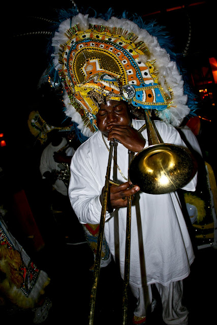 Music from a Bahamian trombone player sweating through his headdress during a performance on Grand Bahama Island.