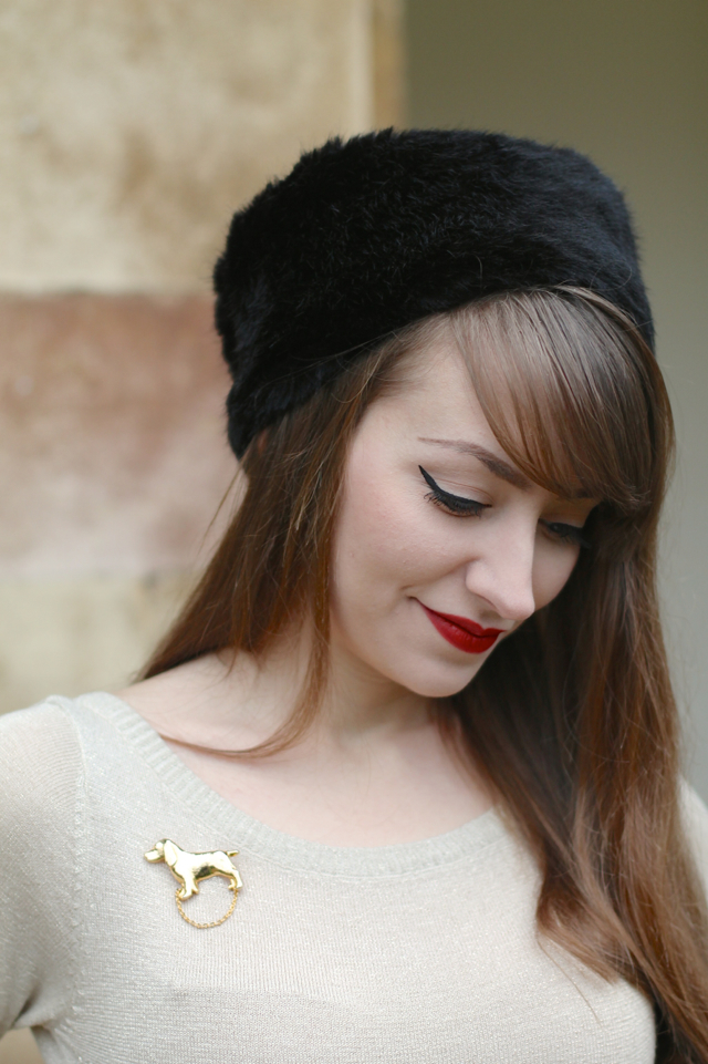 Black fur hat, gold bardot top & gold vintage dog brooch