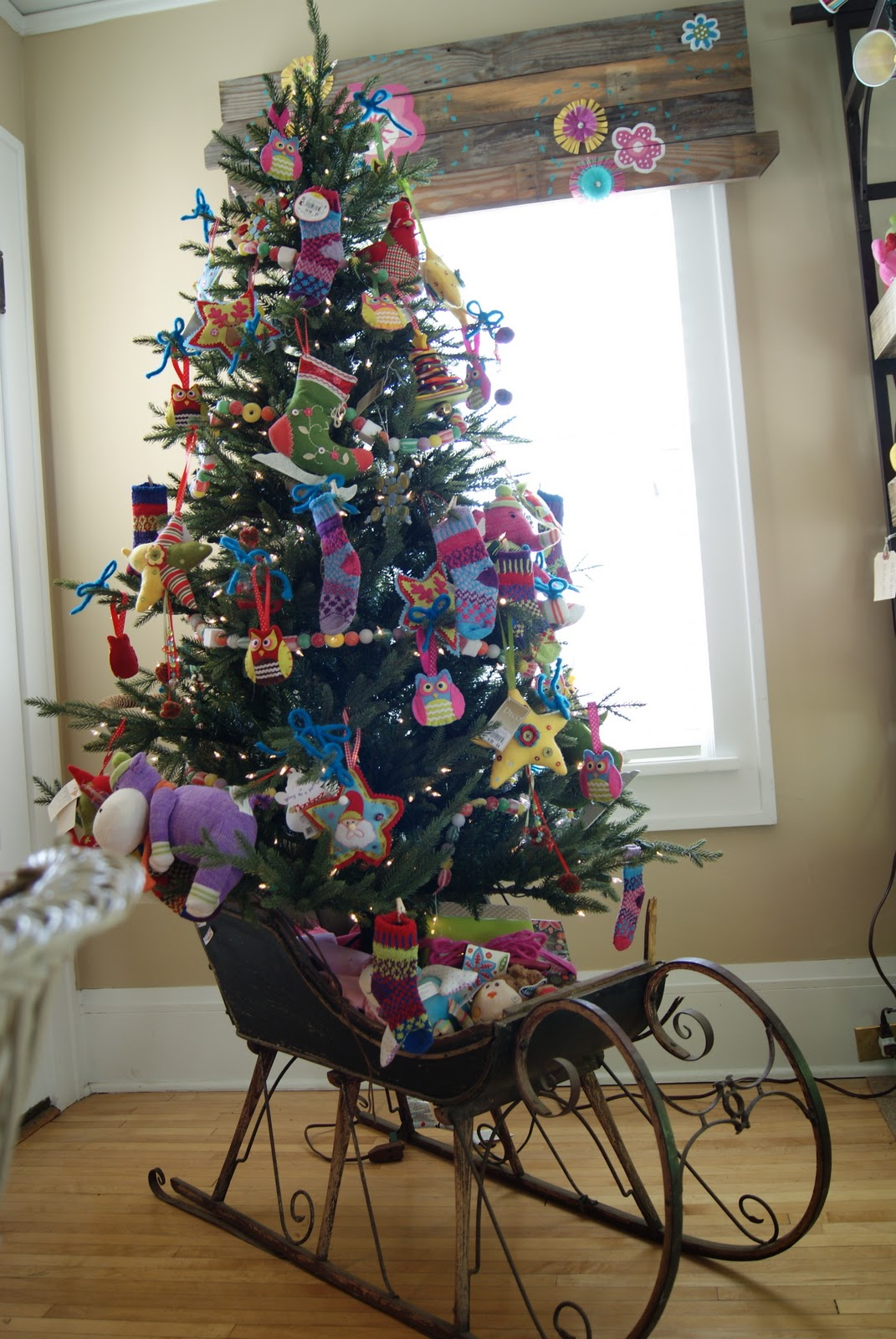 Christmas tree in a vintage child's sleigh