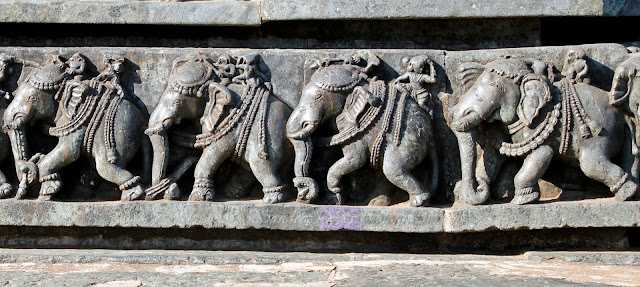 There are about 1248 of these elephants on the base of the temple wall, each one carved uniquely