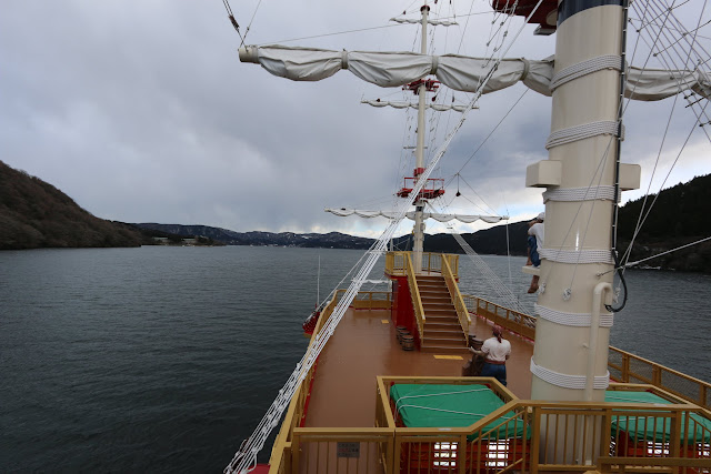 The front view of the Hakone Sightseeing Cruise ship with the breathtaking view of mountains and Lake Ashinoko in Japan