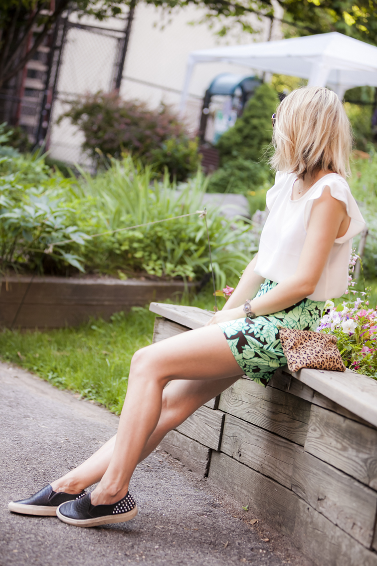 Hanging out in New York City's Upper West Side Community Garden, Sandro slip-on studded Anaconda sneakers, flower tropical print shorts, white silk blouse