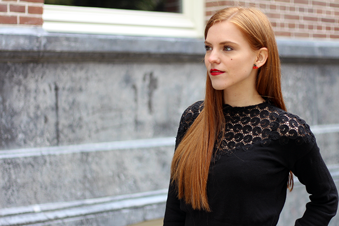 Dutch fashion blogger from amsterdam with red hair wearing a lace sweater and cherry earrings