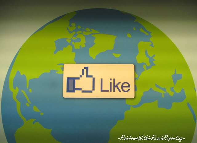 photo of: Earth Day globe with like symbol