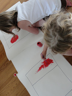 kids painting Canada flag