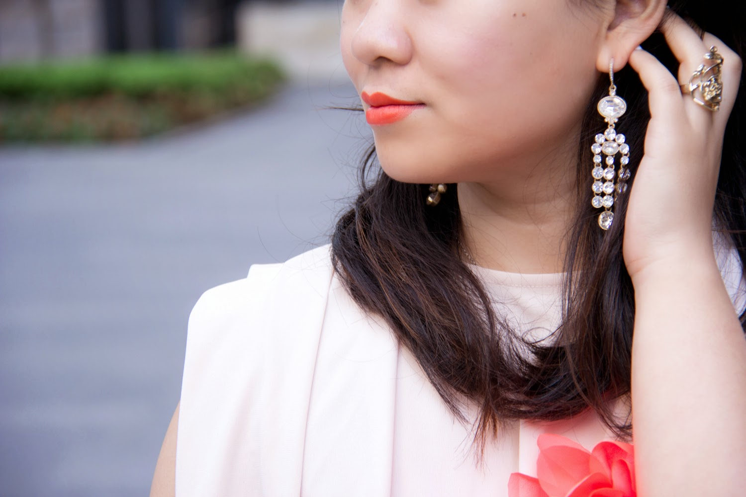 caked-orange-lipstick, club-monaco-statement-earrings, gold-rings