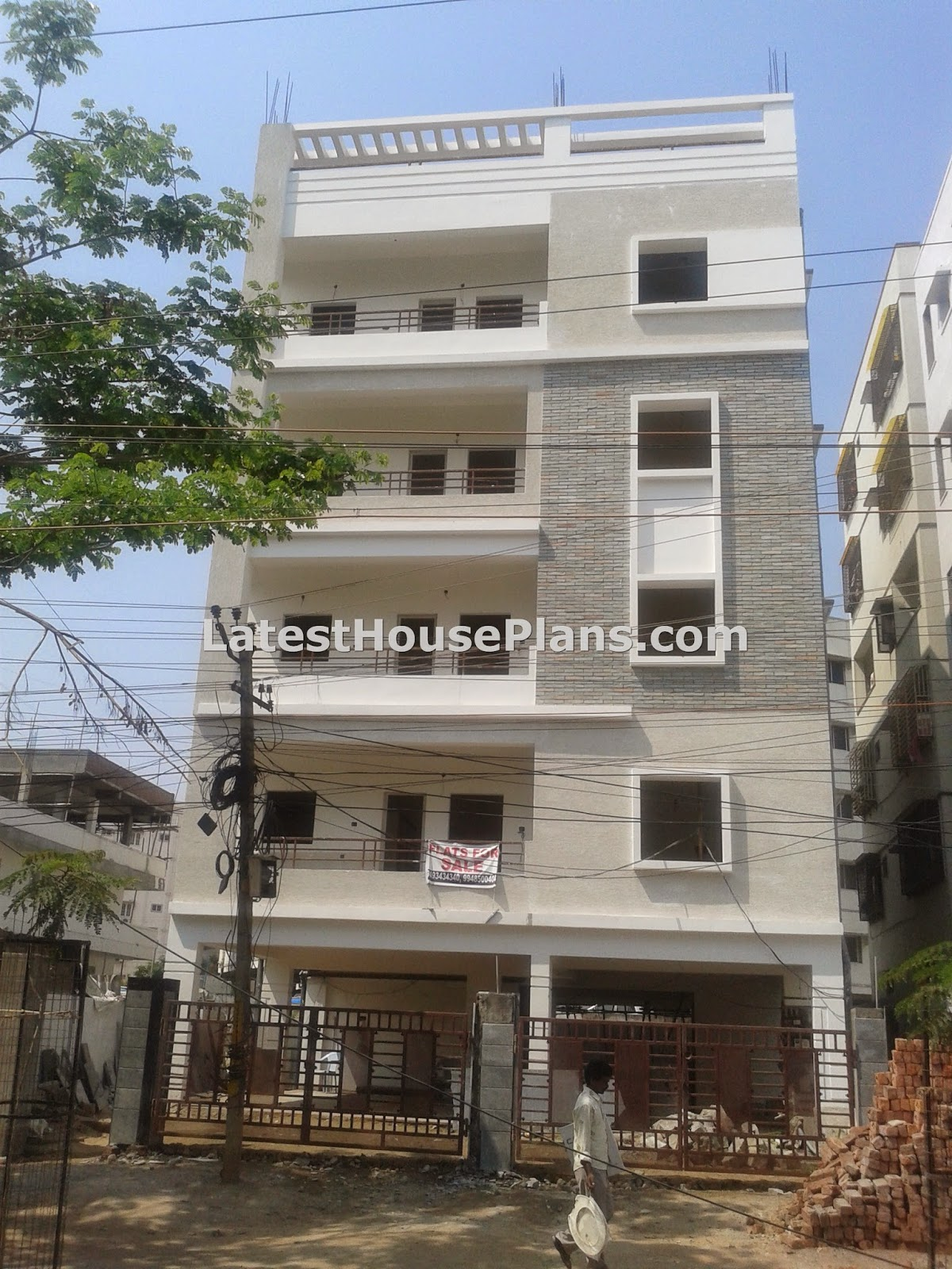 Small four floor apartment elevations in hyderabad for 3 storey building front elevation