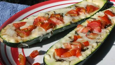 http://bestoflongislandandcentralflorida.blogspot.com/2014/08/caprese-stuffed-zucchini-boats.html