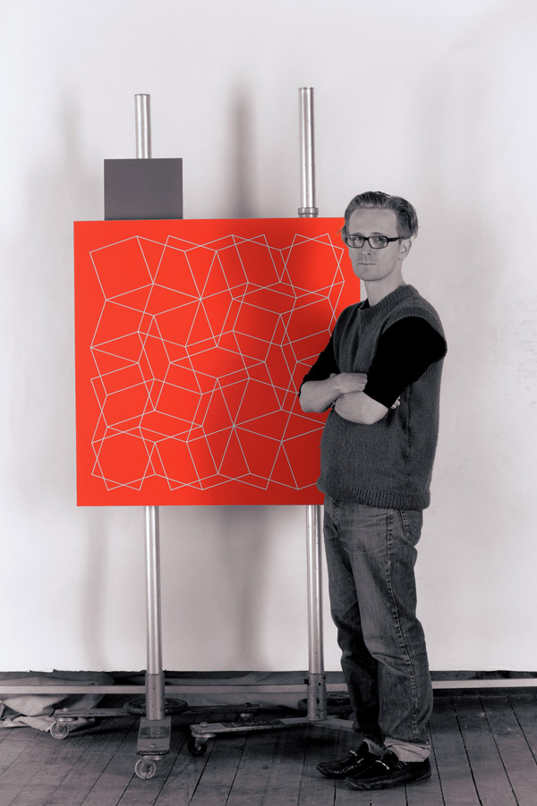 Adrian McDonald with artwork on the 'art copy' set, Balmain studio 2012