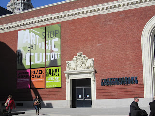 Entrance to San Francisco's Contemporary Jewish Museum, with signs identifying the current exhibits.
