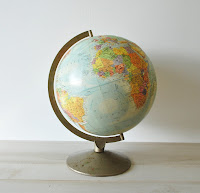small school house globe on a stand