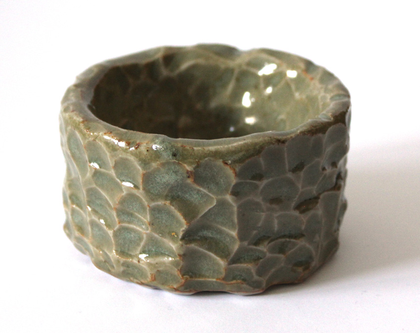 It s about art and design deeply carved pottery bowl