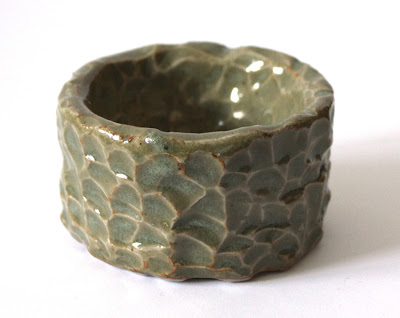 glazed carved pottery bowl