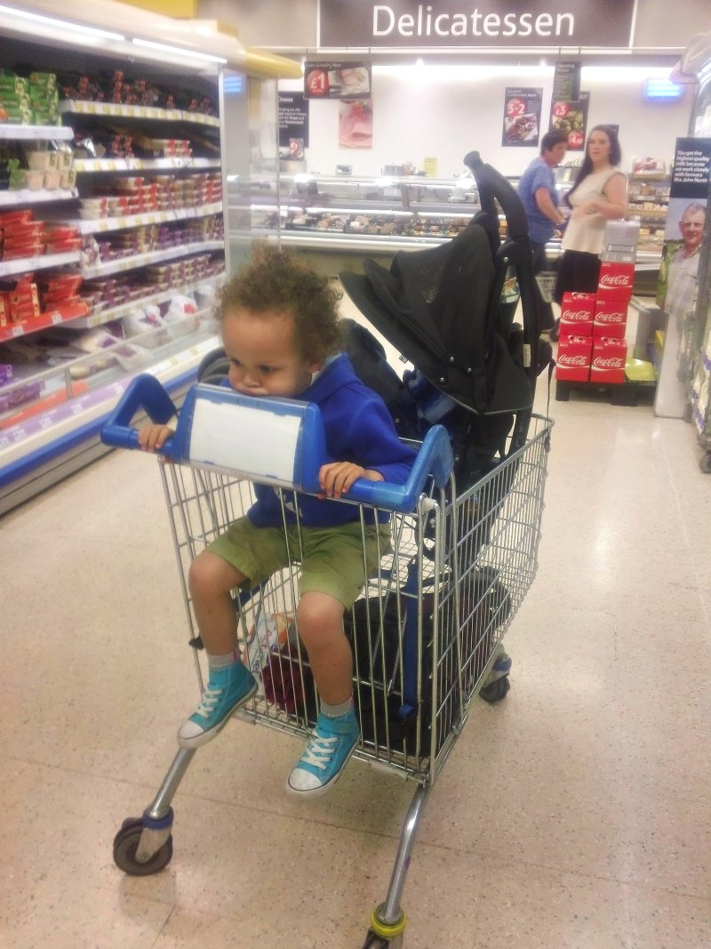 Buggy in supermarket trolley