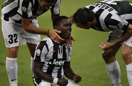 Kwadwo Asamoah celebrates after scoring against Napoli with Juventus teammates