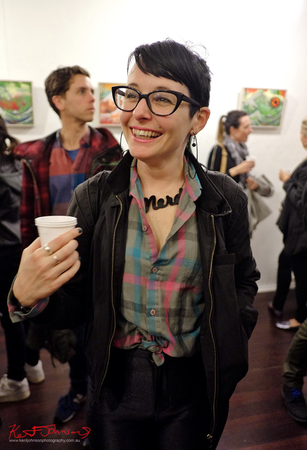 Check Shirt, Hipster Glasses, Bomber Jacket, Black Disco Pants, Nerd pendant necklace. Photography by Kent Johnson.