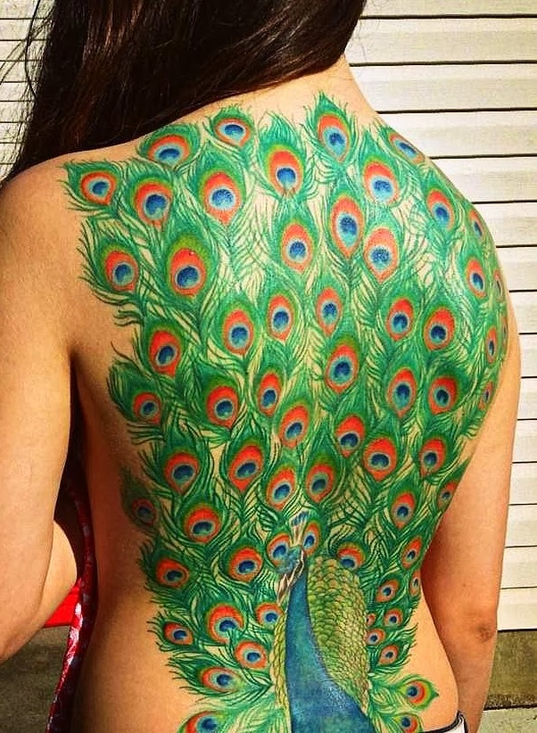 Peacock colorful back tattoo