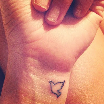 Halcyon Wings: Small Dove Wrist Tattoo
