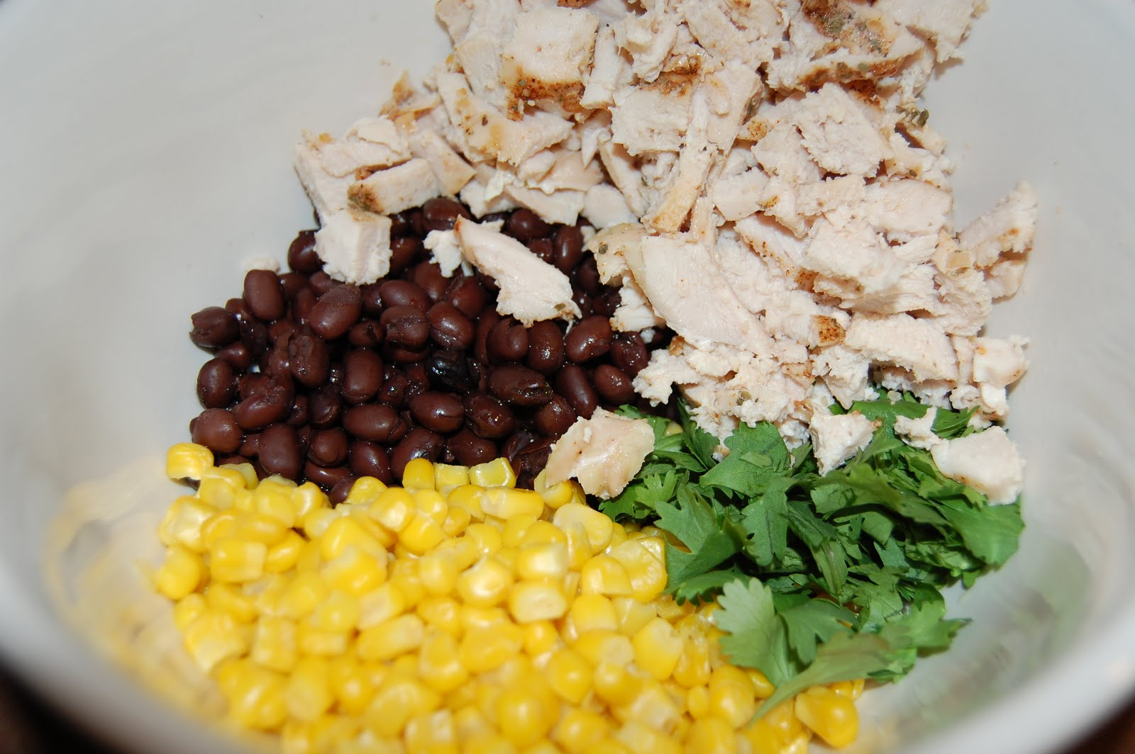 Place the shredded chicken in a bowl and add the black beans, corn ...