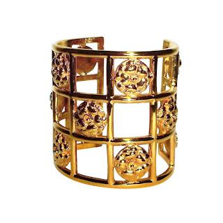 Vintage 1970's gold Chanel camellia cage cuff bracelet.