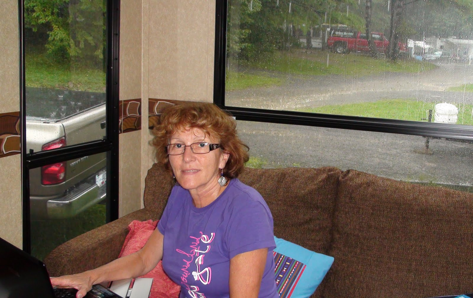 Liz looking out at the rain from our trailer