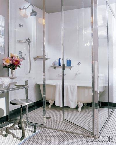 showering in a clawfoot tub.  apartment of fashion designer Lela Rose a partition glass and steel shelters both an open shower for her husband antique claw foot tub Shower or Bath A Flippen Life