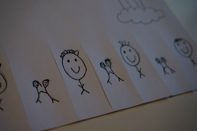child drawing of smiles and hugs