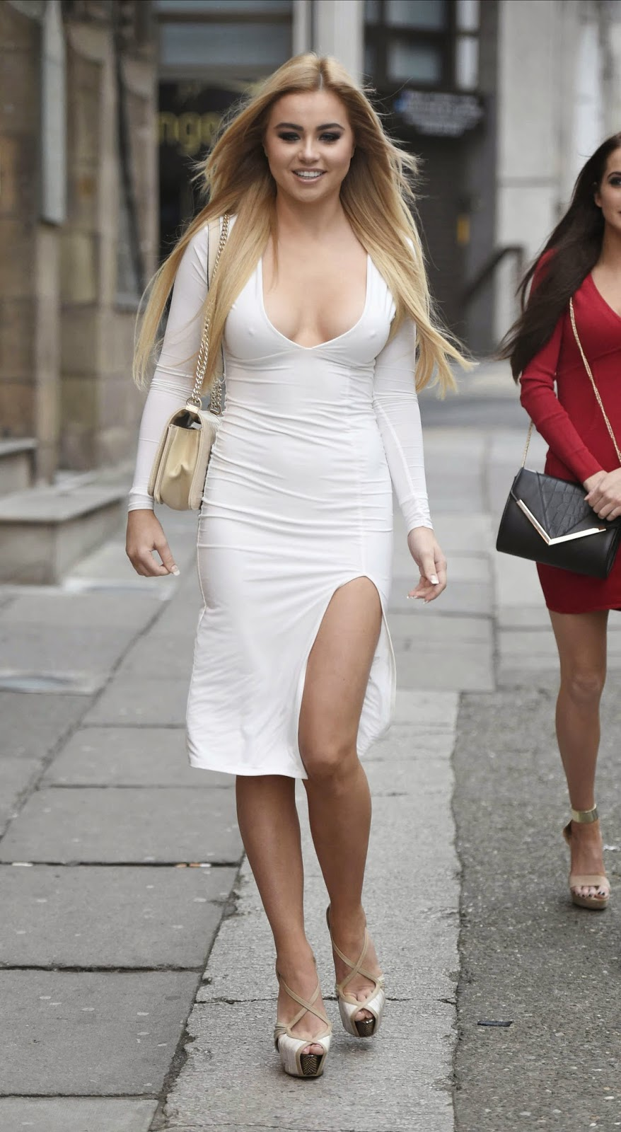Melissa Reeves in a figure hugging white dress at the Bellissimo Brunch Club in Liverpool