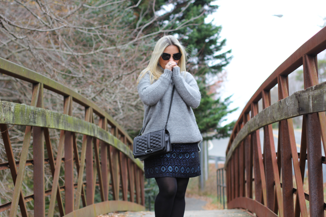 oversized grey sweater and blue skirt