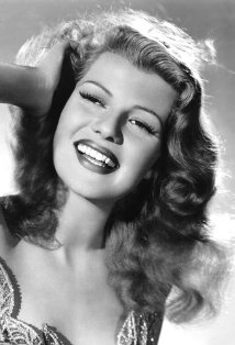 Vintage black and white photo of actress Rita Hayworth.