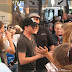 2010-07-21 Candid: Adam Lambert Signing Autographs Before the Concert-Portland, OR