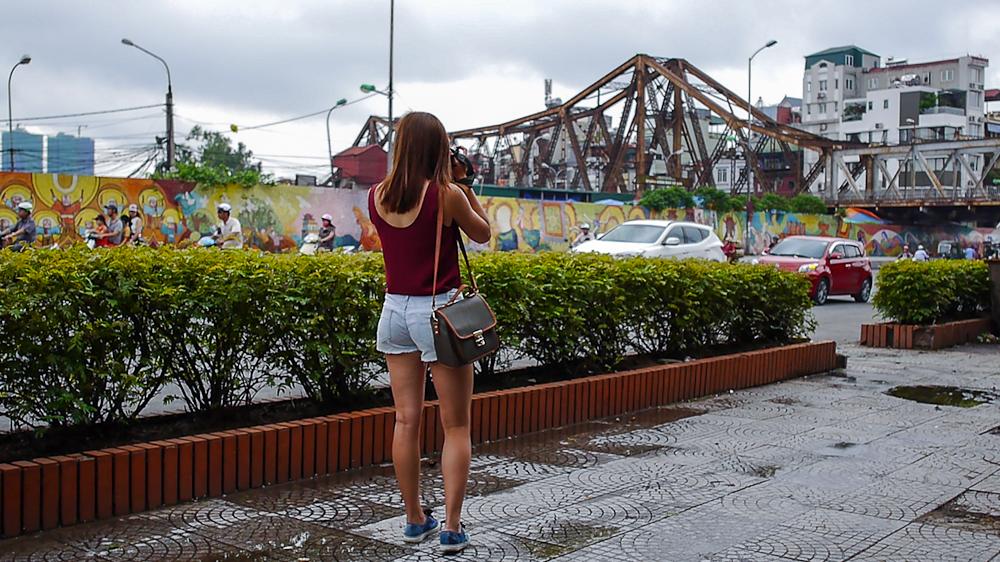 taking a photo of the oldest bridge in hanoi